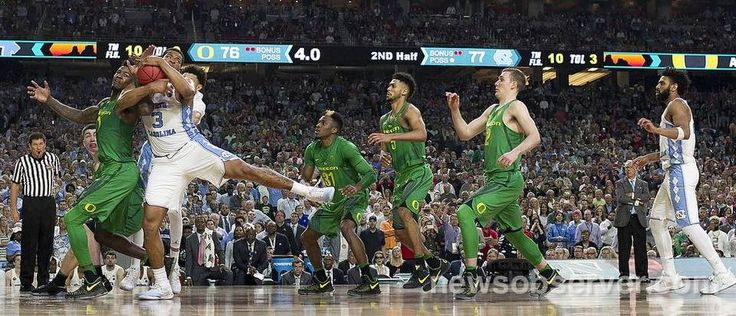 North Carolina's Kennedy Meeks (3) secures an offensive rebound with less than four second to play from Oregon's Jordan Bell (1) to help secure North Carolina's 77-76 victory over Oregon in the NCAA National semifinal game on Saturday, April 1, 2017 at the University of Phoenix Stadium in Glendale, Arizona.