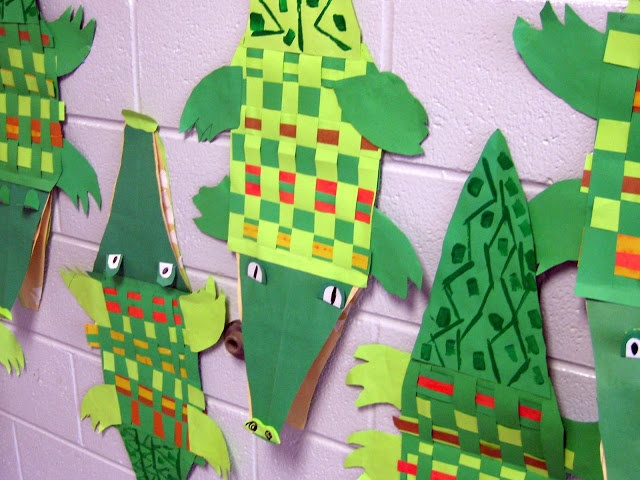"""1st - weaving for the body of a crocodile originally came from pinterest. But art teacher Lauren came up with the genius idea to create crocodile puppets. The eyes pop up by giving them a """"foot."""" Here's the lesson."""