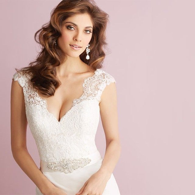 Close up of this gorgeous lace appliqué bodice with the waist accented by a satin sash with Swarovski crystals and intricate beading. Allure Bridals | Bridal | Bride | Wedding gown