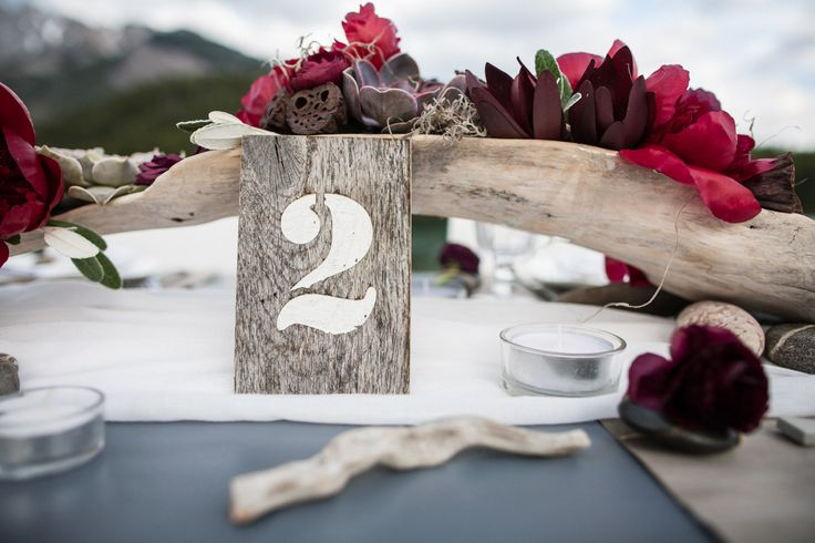 Lake themed wood table number by Naturally Chic  | photo by One-Edition: Weddings by Rafal Andronowski Photography; Florals by Sarah Mayerson Design. #lakesidewedding #nauticalwedding #banffwedding