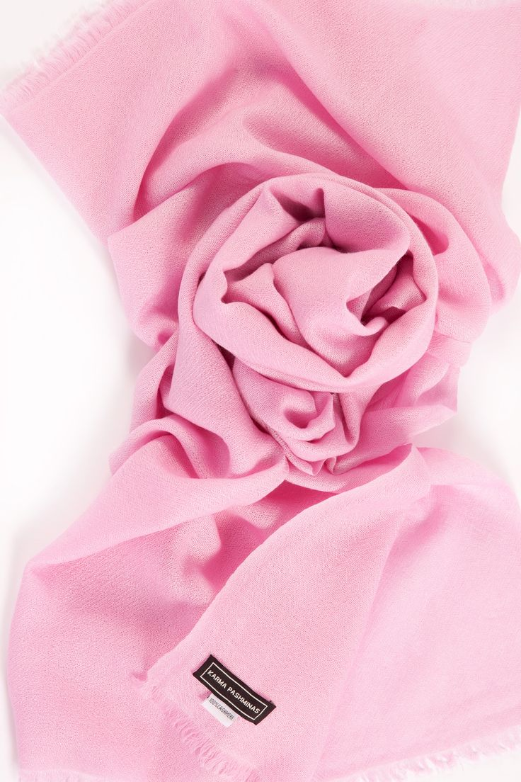 Handwoven Baby Pink Karma Pashmina ( a signature collection of Karma Cashmere ) !  A subtle blend of soft rose and cream hues, this delicate pink cashmere weave is the perfect complement to any collection, exuding both confidence and femininity.