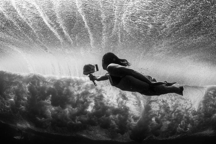 Paddling out in sets as big as 50ft, is just another day in the office for surf photographer, Lucia Griggi.