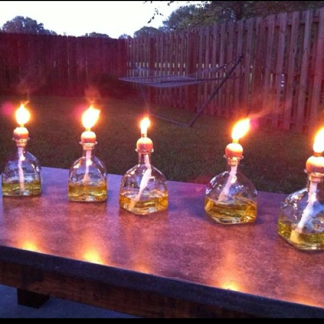 Up cycled patron bottles into tiki torches.