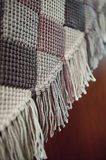 The Squared Away Throw is the ideal blanket for crocheters looking to explore new skills. By combining Tunisian crochet with the technique known as entrelac, this unique blanket creates a series of triangles and cubes to compose a bold geometric design. Worked in worsted weight yarn, this throw is finished off with fringe along the top and bottom edges.