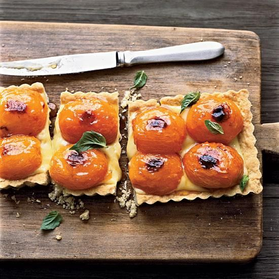Apricot-and-Basil Shortbread Tart | Roy Shvartzapel layers roasted fresh apricots atop basil custard to make a gorgeous tart. The tender crust is extraordinary: Combining hard-boiled egg yolk and potato starch, it's based on a classic dough that he learned from Paris pastry genius Pierre Hermé. The ideal wine match: Tokaji.