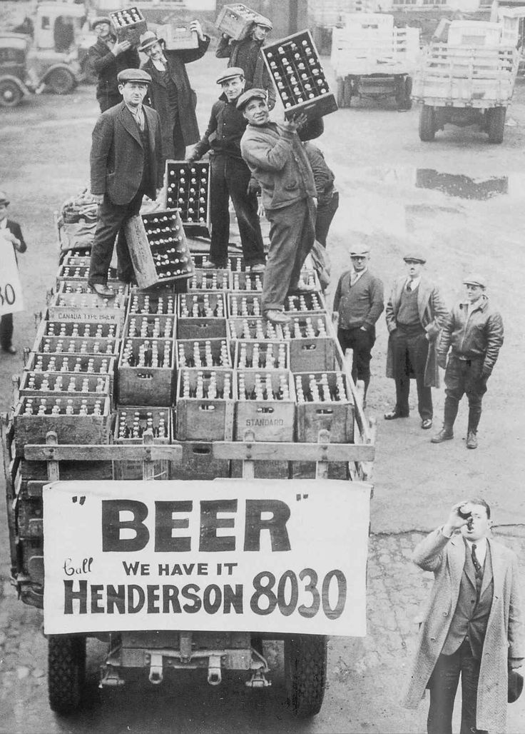 Men atop beer delivery truck hoist cases of beer triumphantly while man standing in front of truck drinks out of beer bottle following the repeal of Prohibition. (Source: Time Life Pictures)