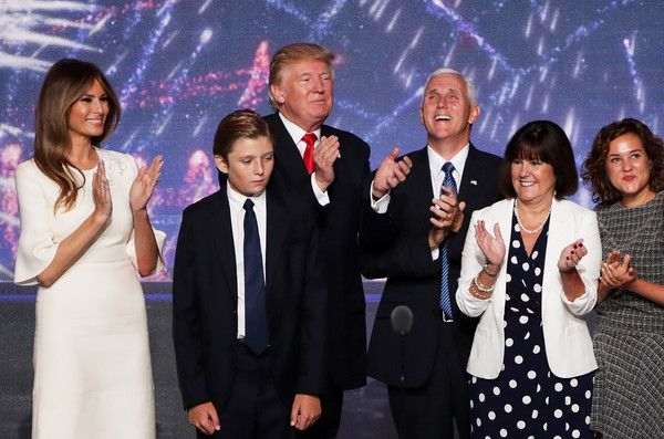 Melania Trump Photos Photos - Republican presidential candidate Donald Trump (Center-L) stand with his son Barron Trump, and wife Melania Trump (L) as Republican vice presidential candidate Mike Pence (Center-R) stands with his wife Karen Pence (2nd-R)  and daughter Charlotte Pence (R), at the end of the Republican National Convention on July 21, 2016 at the Quicken Loans Arena in Cleveland, Ohio. Republican presidential candidate Donald Trump received the number of votes needed to secure…