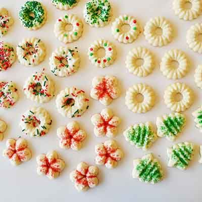 The best ever recipe for buttery spritz cookies with festive variations, perfect for a Christmas party dessert.
