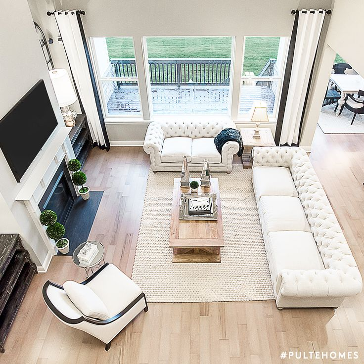 A Stunning Open Living Space With Mixed White Tones Is The Perfect Room For  All Your