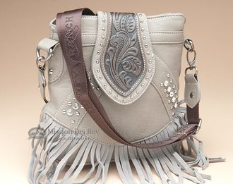 Beautiful rustic purses are perfect for anyone who loves southwestern handbags and western or native style fashion.