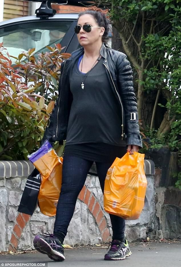 Keeping it casual: Jessie Wallace looked worlds away from her leopard print-loving EastEnders alter-ego, Kat Slater, as she ran errands in north London on Tuesday