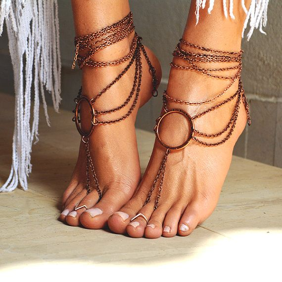 Women Barefoot Sandal Ancient Rome.  A pair of handcrafted barefoot sandals, with bronze antique chain.   *They have a round bronze metallic charm in the center from where 3 rows of chain are griped until the back of the foot.  *The closure is adjustable. It has a bronze clasp at the back.*   **You can wear them barefoot in the beach or with your favorite pair of sandals even high heels!**