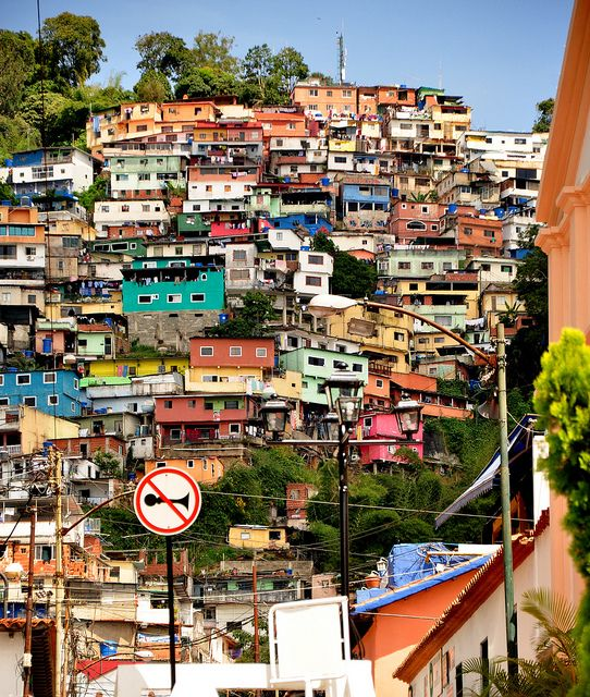 "Caracas ~ this is called shantytown and it is a huge mountain literally covered with these shanties ~ although this looks ""quaint"" in the photo, shanty town is riddled with poverty and violence and is in stark contrast to the modern city below ~ talk about dichotomy ~"