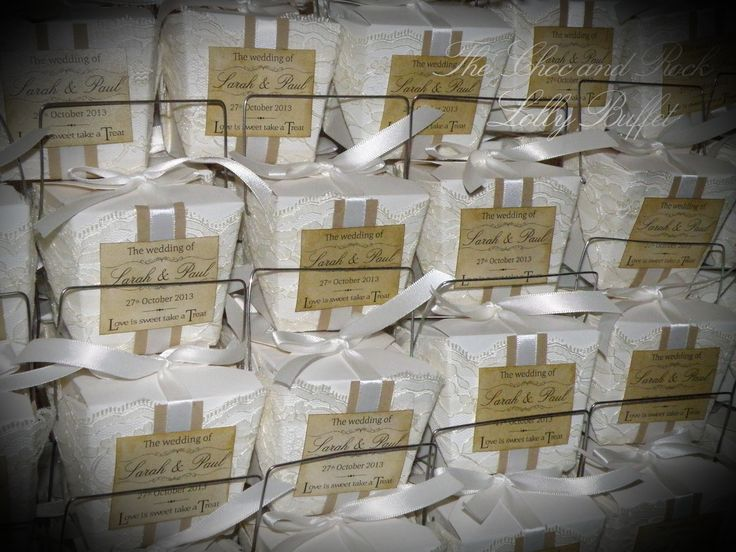The noodle boxes took weeks to complete! .. We pulled them apart 1 by 1, wrapped lace around them and put them back together .. then we wrapped kraft paper and ribbon around them and tied it in a bow - with a vintage label.  The lace, kraft paper and ribbon were also used the invitations and menu's.   www.facebook.com/thechocandrocklollybuffet www.thechocandrock.com