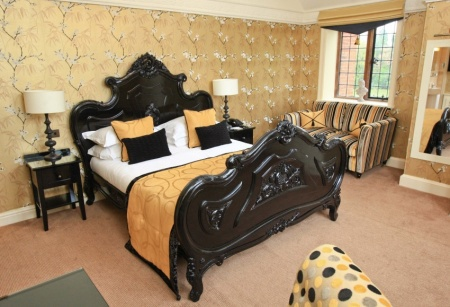 The bed is the statement of this room at Inglewood Manor. The dark wood contrasted with the black, gold and yellow colours put a modern twist on an otherwise classical look. So perfect  is it to relax in, we're confident you won't want to.