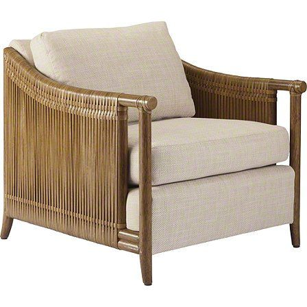 Utilizing two of McGuire's signature materials, rattan and rawhide, the Jolie Lounge Chair bridges the classic McGuire design aesthetic with a modern execution. Thick strips of rawhide are tightly wrapped around the softly curved rattan sides, creating an impression that is at once solid and refined from a distance, yet light and accessible up close.