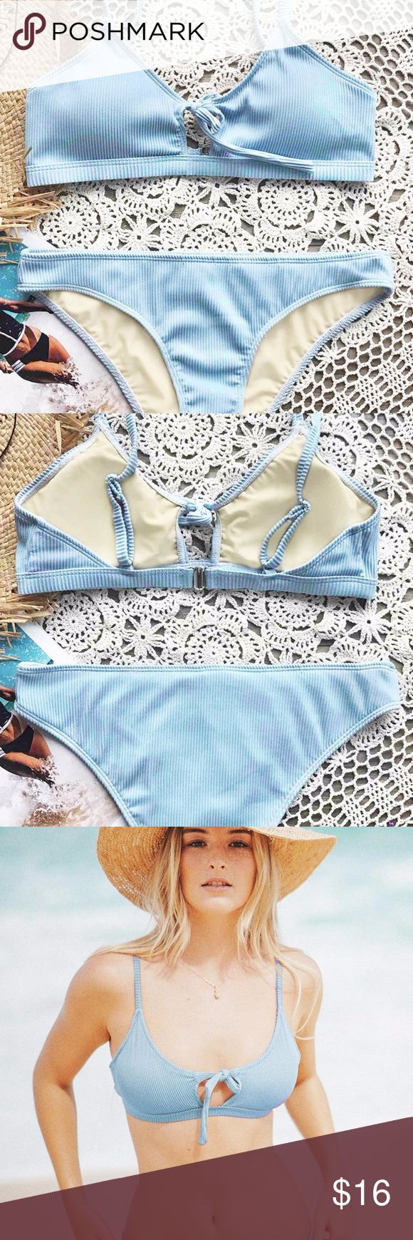 Blue Fluffy Cloud Tie Bikini Set A cute baby blue bikini with a front tie. The bikini features adjustable shoulder straps, a back hook closure and a padding bra. The bikini is double-layered with a special Chinlon, Elastane fabric. Both top & bottom are size small. Swim Bikinis