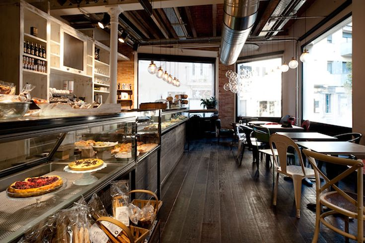 funky bakery called Serrajòrdialocated in the town of Sant Cugat del Valles near Barcelona. It was designed by interior design firm AM_Asociadosand is a fantastic mix of industrial and vintage