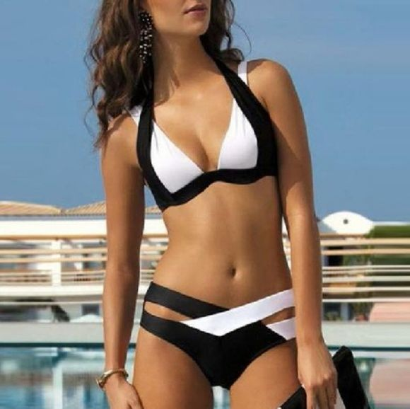 "***COMING SOON*** Two Piece Halter Swimsuit DO NOT BUY YET. Black and white two piece halter swimsuit. Polyester, spandex. Low waist. Wire free. Size large. Bust 35.8""-37.8"". Waist 28""-29.9"". Hips 37.8""-39.8"". Swim Bikinis"