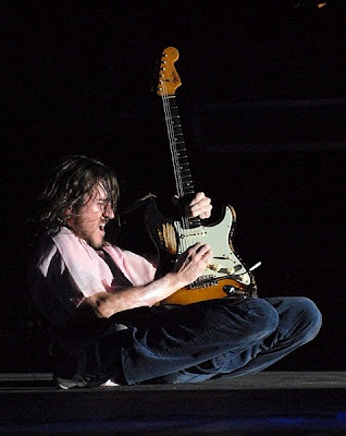john frusciante no one can play like this man!! It's like he's one w/his guitar!! He loses himself in the music  it's an experience to watch!