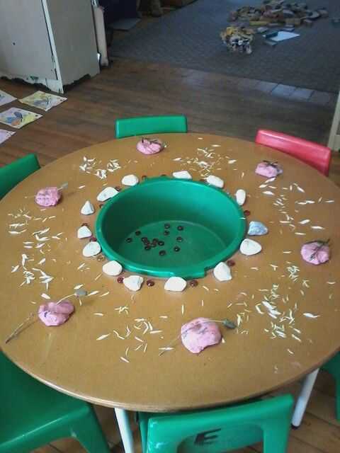 Lavender play dough,  petals and pebbles for spring theme