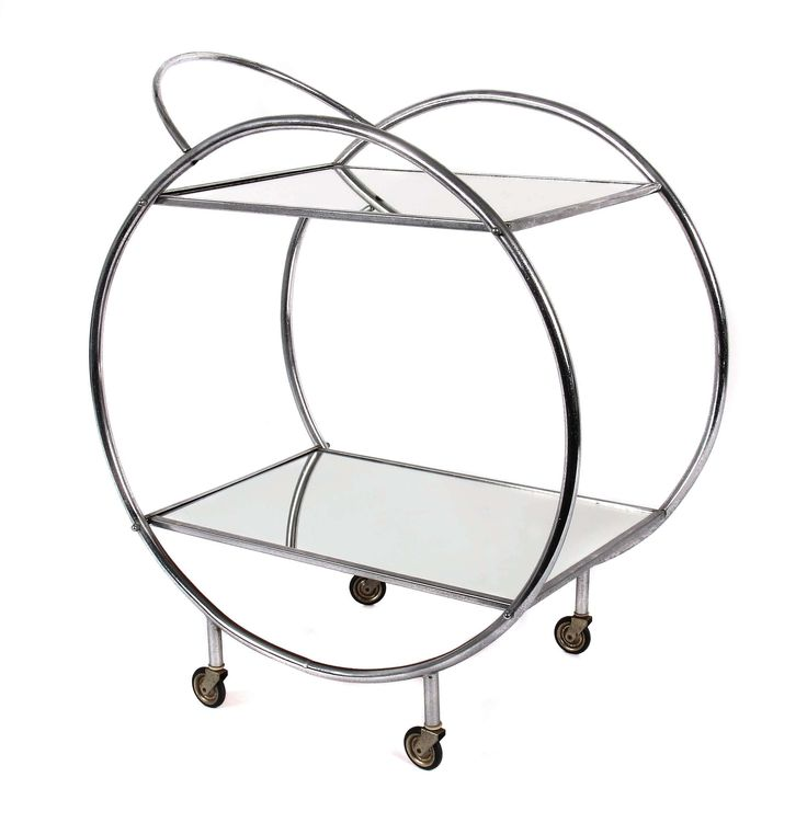 Tea trolley 1930s, probably Germany, design chrome-plated tubular steel, two frames circles on four short legs with castors, the two shelves in mirrored glass, framed, HxTxB: 74/39/62, 5 cm. Normal signs of age.