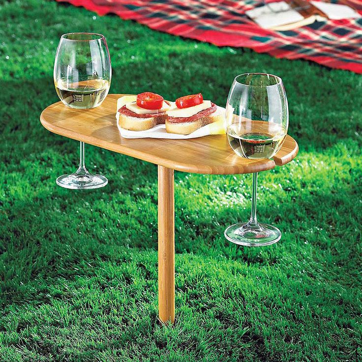 Bamboo Travels Wine Post Table | dotandbo.com - The Bamboo Travels Wine Post Table is a wine and park enthusiast's dream. It packs flat for easy carrying. Stretch out and relax on the grass or beach with your significant other sipping your favorite wine and sharing a cheese spread for two.