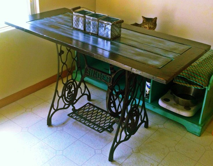 Kitchen table made from vintage door and Singer sewing machine base.