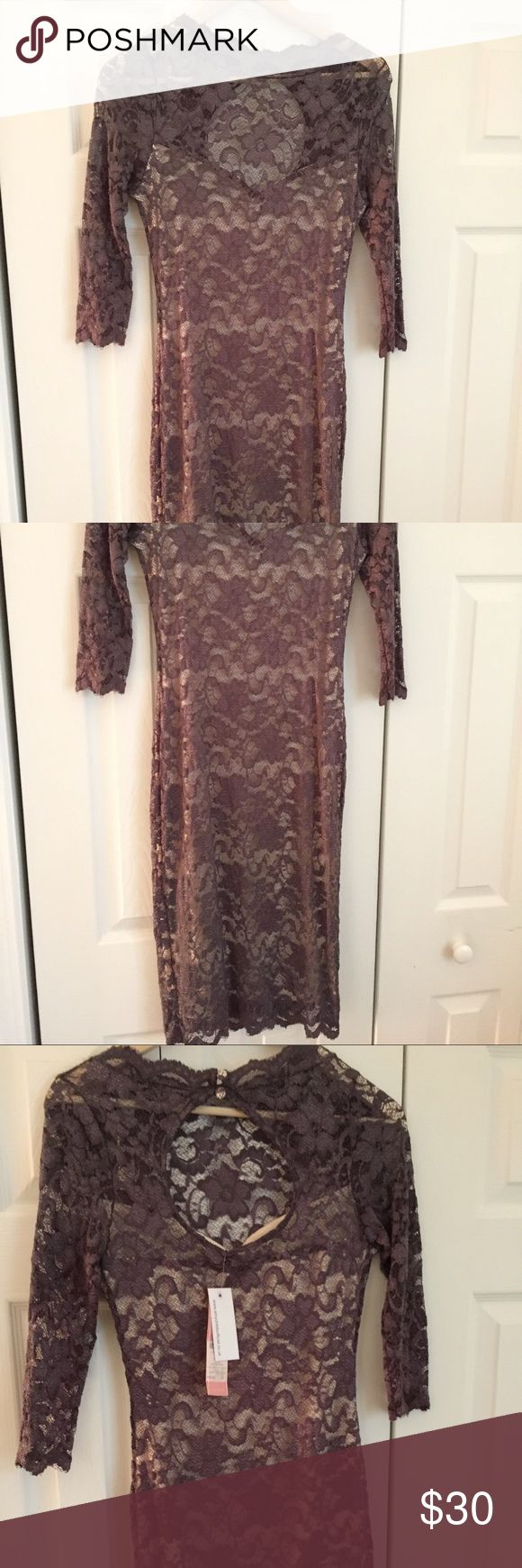 Amy Child's Lace gray dress Never worn Gray lace dress. It is lined and has opening in the back. New with tags. Fits as a 10. Measures 38 inches from top to bottom. Dresses Midi