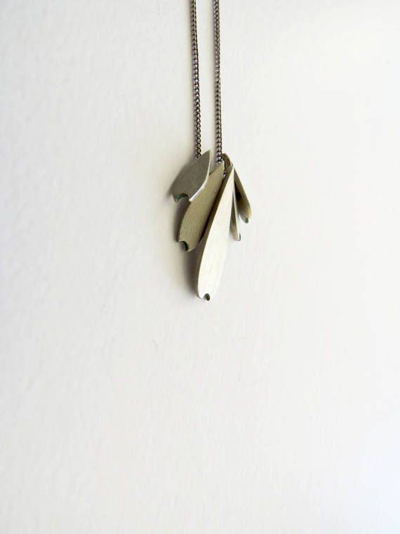 This dainty pendant is made with 5 tiny abstracted daisy petals made from sterling silver. All 5 petals have brushed finishing and it is totally handmade. The chain is made from sterling silver.  Its dimensions are 4.3 cm in length and 2.5 cm in width.   Please feel free to convo me any time with questions. Thanks for stopping by!   Please do take time to read my Policy section before purchasing.  ----------------------------------------------------------------------------------- All my…