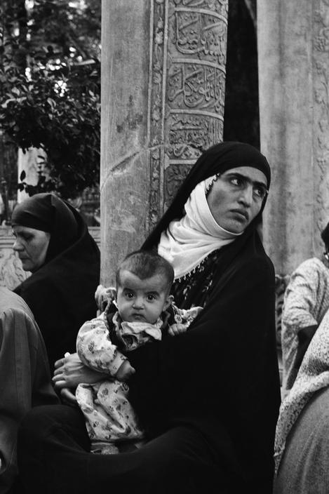Pilgrims in the courtyard of the Mosque at Eyup, Istanbul, photo by Ara Güler