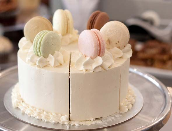 A lovely Macaron Topped Cake from Bobbette and Belle in Leslieville at 1121 Queen Street East