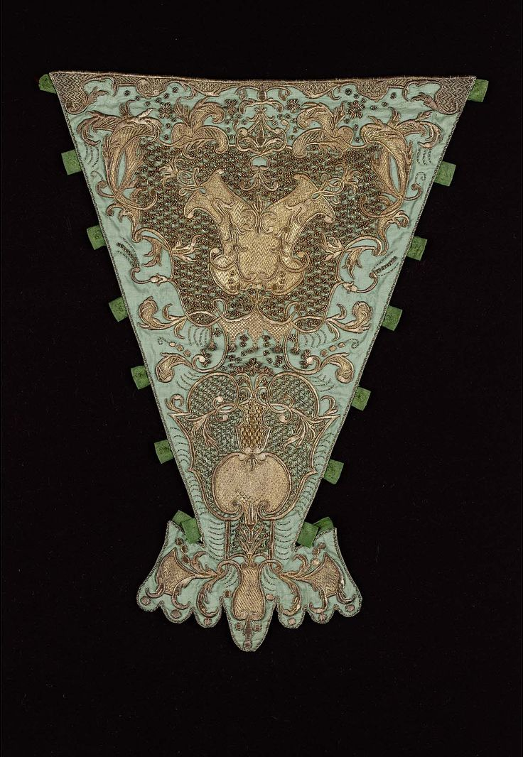 French or Italian late 17th–early 18th century Object Place, France or Italy DIMENSIONS 42 x 33 cm (16 9/16 x 13 in.) Tabs are included. ACCESSION NUMBER 38.1342 MEDIUM OR TECHNIQUE Silk, gilt-silver; embroidery COLLECTIONS Europe, Textiles and Fashion Arts CLASSIFICATIONS Costumes Gilt-silver yarns and wires embroidered on blue silk ground. Conventionalized vegetative design. Green silk tabs at sides (original). Matching collar band (38.1214), q.v.