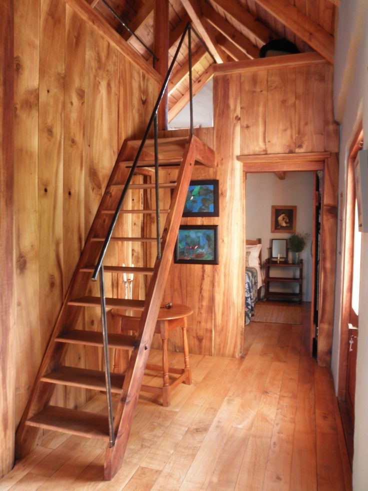 The hallway, with stairs up to the sleeping loft, at Fynboshoek Cottage , a farmstay in Stormsrivier, South Africa