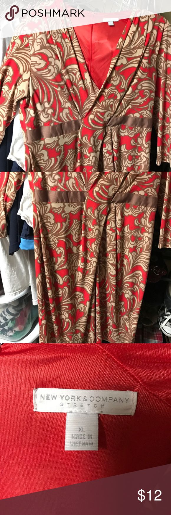 Nice dress New York and company extra large dress. Cream and dark orange or terra-cotta in color. Worn once or twice. Going for a low price. Must go! Cleaning out closet! Smoke and pet free home! Get it before someone snatches it up New York & Company Dresses