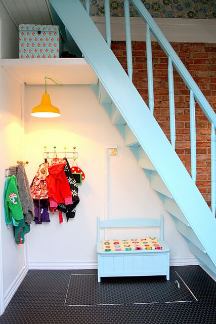 cute under the stairs mudroom-type area
