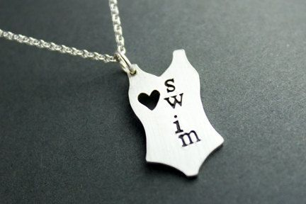 A special charm for those who love swim. This cute little bathing suit is cut from sterling silver and hand stamped. It is then hung from a sterling