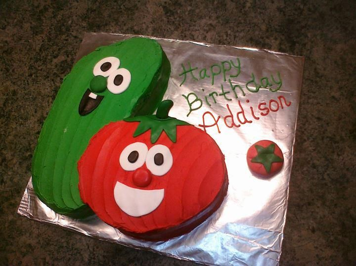 Veggie Tales cake...think this would be cute, with 2 small cupcakes on the side to hold candles, won't mess up the cake then.
