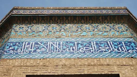 The Perfect Companion: A decorated upper hexagonal wall of the shrine of Jafar ibn Abi Thalib RA (d. 629 AD). Though the original building was erected during Ilkhanid period of 13th cent AD, The blue foliage tiling on the roof, the kufic inscription on the upper wall as well as the blue tile of Thuluth Qur'anic inscription which indicate the site was heavily restored during Timurid empire in late 14th until early 16 cent AD.   Esfahan, April 2017.