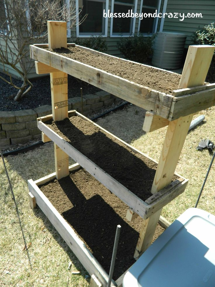 DIY Gardening box made from pallets. Perfect for a small yard. From blessedbeyondcrazy.com