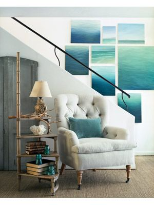 Love the simple ocean photos, tailored chair, rustic decorative branch, and blue accent pieces. Beach Home Decor Photos from The Nest