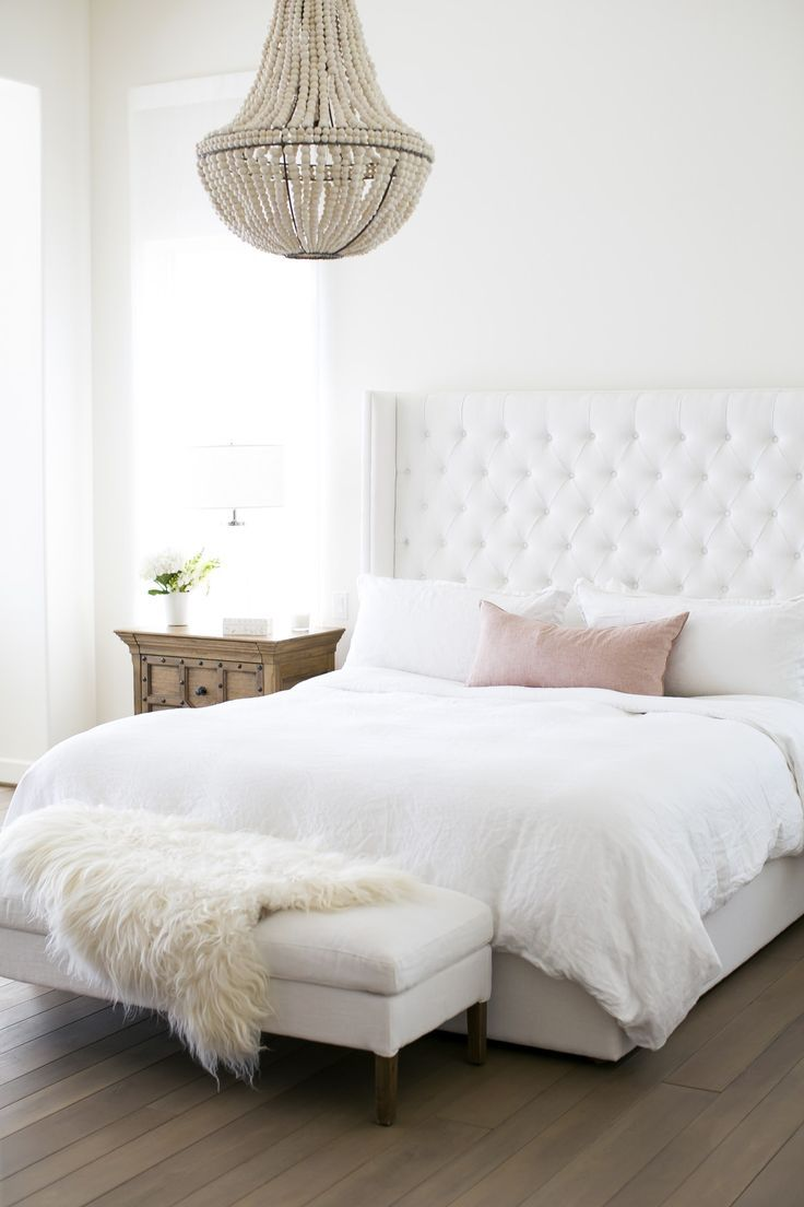 Pretty And Feminine Bedroom With White Upholstered Headboard With