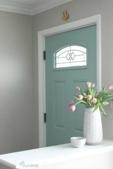 Grey walls, teal door, white trim