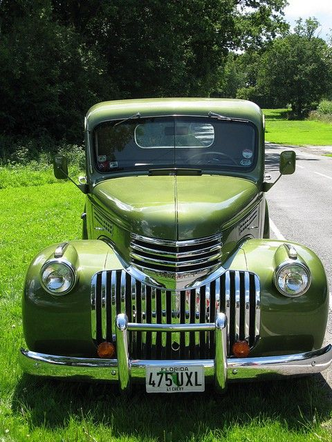 A truck so green it practically blends in with the lush grass.                                                                                                                                                                                 Plus