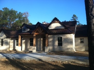 Texas Ranch House Style With Stone Metal Roof Accent And