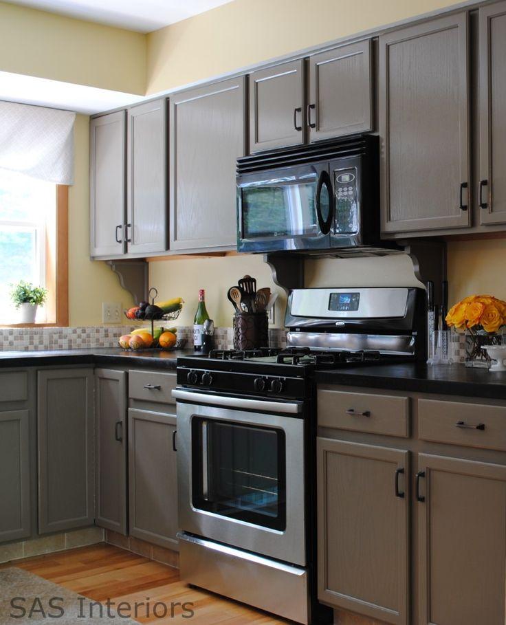 Wonderful taupe kitchen by Jenna of SAS Designs in Saratoga Springs - she painted her natural wood cabinets in my favorite paint color - Benjamin Moore's Berkshire Beige - great work!