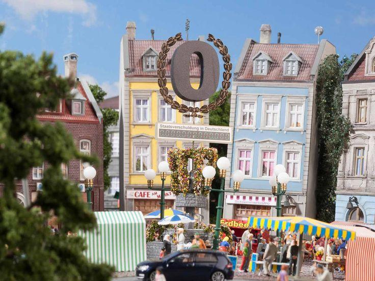 """Denkmal Schwarze Null: Im Zentrum steht für die FDP """"die Schwarze Null"""". Die liberale Stadt ist schuldenfrei. Das ist auch unser Ziel für Deutschland. Wir sind auf einem guten Weg: Für 2014 haben wir den ersten strukturell ausgeglichenen Bundeshaushalt seit über 40 Jahren vorgelegt. Nur mit uns sind Entlastung und Schuldenabbau zeitgleich möglich."""