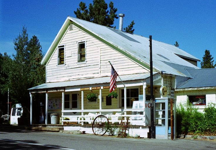 General Store, Markleeville, California, USA This great old General Store is of a type that was common in small towns in the snowy regions of California. It has a steep corrugated steel roof that sheds snow; a chimney that does straight down to the center of the store where a pot bellied stove can heat it in winter; a nice long porch to enjoy ice cream or lemonade in summer; ice machines for fisherman, hunters and campers; a telephone for travelers and locals without one; and a bulletin…