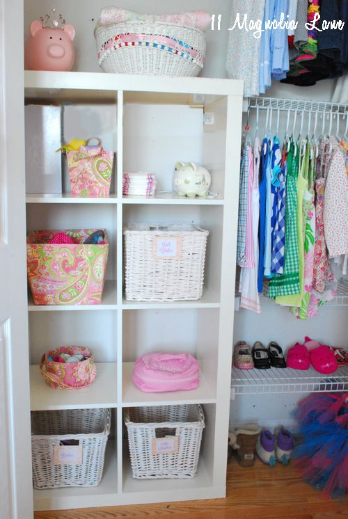 girls closet organization, shelves attached to an Ikea expedit bookcase provides great kid-friendly storage options.