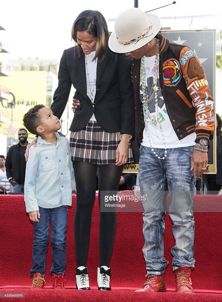Singer-Songwriter Pharrell Williams (R), wife Helen Lasichanh and son Rocket Ayer Williams attend the ceremony honoring Pharrell Williams with a star on the Hollywood Walk of Fame on December 4, 2014 in Hollywood, California.